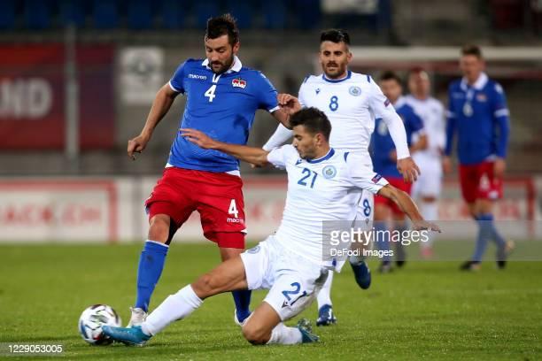 Daniel Kaufmann of Liechtenstein and Lorenzo Lunadei of San Marino battle for the ball during the UEFA Nations League group stage match between...