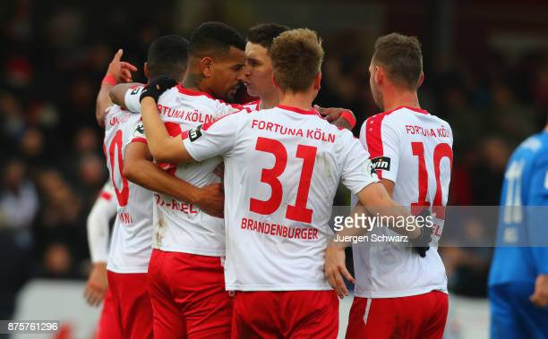 Daniel KeitaRuel of Cologne is hugged by team mates after scoring during the 3 Liga match between SC Fortuna Koeln and 1 FC Magdeburg at Suedstadion...
