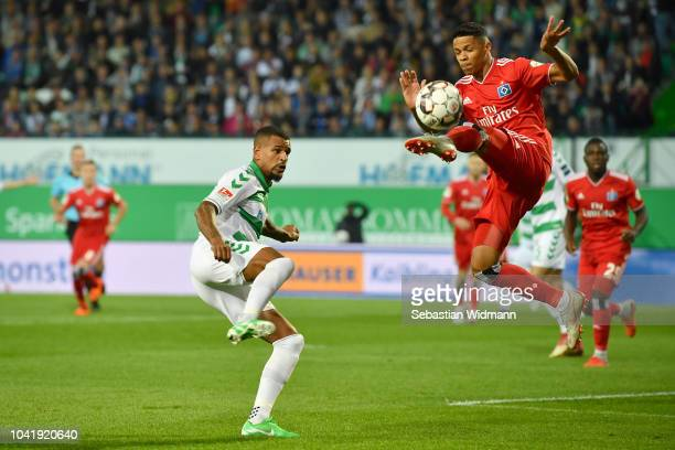 Daniel KeitaRuel of Fuerth and Douglas Santos of Hamburg compete for the ball during the Second Bundesliga match between SpVgg Greuther Fuerth and...