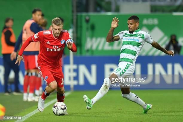 Daniel KeitaRuel of Fuerth challenges Aaron Huntof Hamburg for the ball during the Second Bundesliga match between SpVgg Greuther Fuerth and...