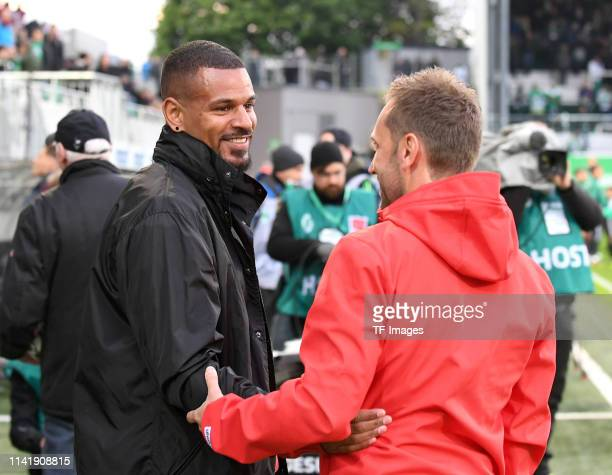 Daniel KeitaRuel of Greuther Fuerth and Head coach Andre Pawlak of 1 FC Koeln laugh during the Second Bundesliga match between SpVgg Greuther Fuerth...
