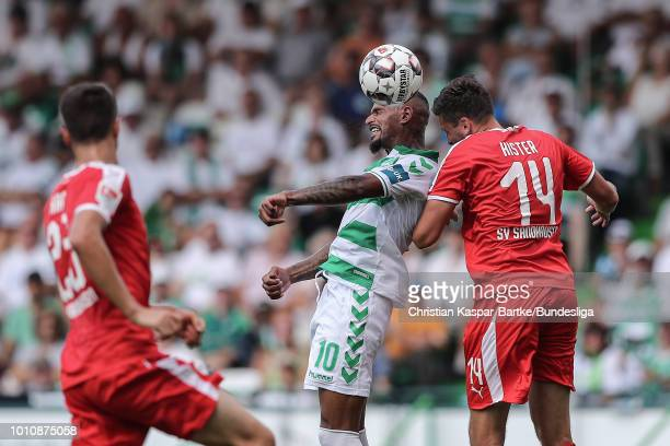 Daniel KeitaRuel of Greuther Fuerth challenges Tim Kister of Sandhausen during the Second Bundesliga match between SpVgg Greuther Fuerth and SV...