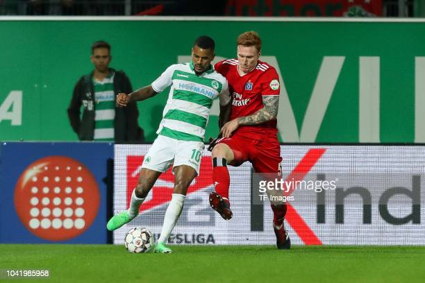 Daniel KeitaRuel of SpVgg Greuther Fuerth and David Bates of Hamburger SV battle for the ball during the Second Bundesliga match between SpVgg...