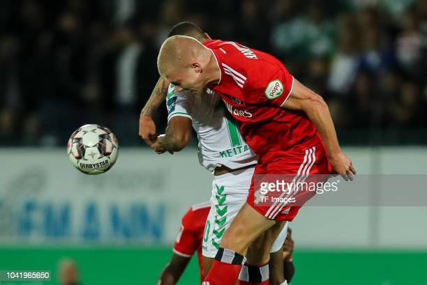 Daniel KeitaRuel of SpVgg Greuther Fuerth and Rick van Drongelen of Hamburger SV battle for the ball during the Second Bundesliga match between SpVgg...