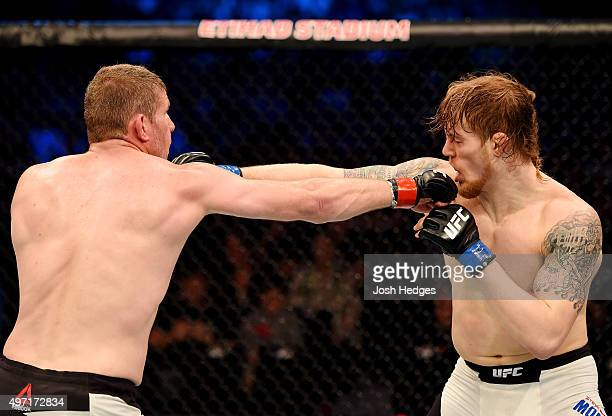 Daniel Kelly and Steve Montgomery exchange punches in their middleweight bout during the UFC 193 event at Etihad Stadium on November 15 2015 in...