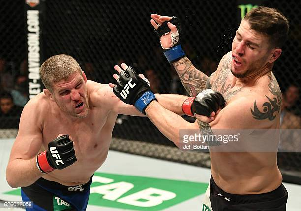 Daniel Kelly of Australia punches Chris Camozzi in their middleweight bout during the UFC Fight Night event at Rod Laver Arena on November 27 2016 in...