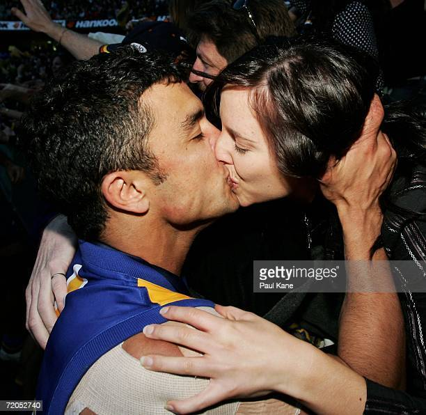 Daniel Kerr of the Eagles kisses his partner Melanie Cousins after the AFL Grand Final match between the Sydney Swans and the West Coast Eagles at...