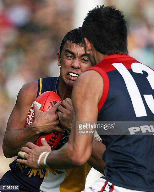 Daniel Kerr of the Eagles looks to get tackled by Adem Yze of the Demons during the round nine AFL match between the West Coast Eagles and the...