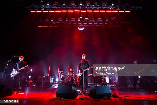Daniel Kessler Paul Banks and Brad Truax of Interpol perform at O2 Apollo Manchester on November 16 2018 in Manchester England