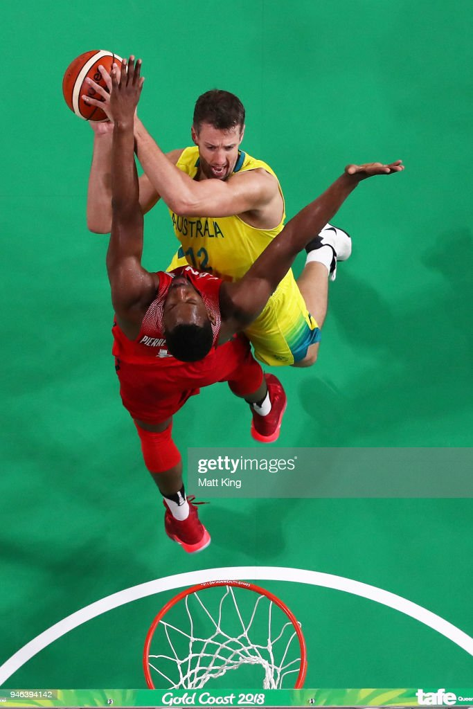 Daniel Kickert of Australia is challenged by Jean Pierre-Charles of Canada during the Men's Gold Medal Basketball Game between Australia and Canada on day 11 of the Gold Coast 2018 Commonwealth Games at Gold Coast Convention and Exhibition Centre on April 15, 2018 on the Gold Coast, Australia.