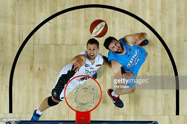 Daniel Kickert of Melbourne United and Alex Pledger of the NZ Breakers compete for the rebound during the round 15 NBL match between the New Zealand...