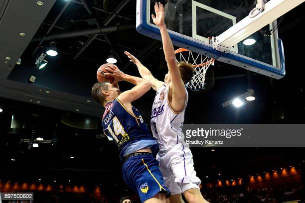 Daniel Kickert of the Bullets takes on the defence of Brad Newley of the Kings during the round 11 NBL match between the Brisbane Bullets and the...