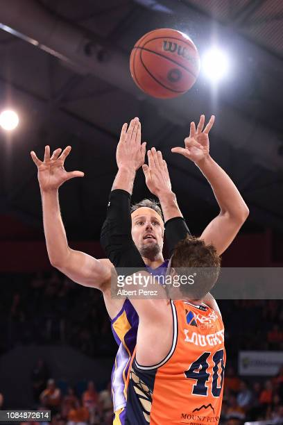 Daniel Kickert of the Kings and Alex Loughton of the Taipans compete for the ball during the round 10 NBL match between the Cairns Taipans and the...