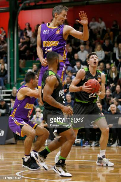 Daniel Kickert of the Kings defends on Dane Pineau of the Phoenix during the NBL Blitz pre-season match between Sydney Kings and S.E. Melbourne...