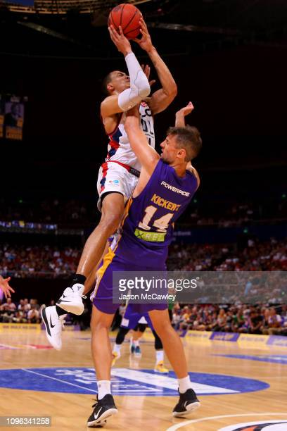 Daniel Kickert of the Kings is fouled by Jacob Wiley of the 36ers during the round 14 NBL match between the Sydney Kings and the Adelaide 36ers at...