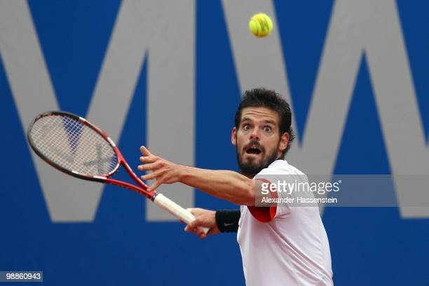 Daniel Koellerer of Austria plays a forehand during his match against Philipp Petzschner of Germany at day 4 of the BMW Open at the Iphitos tennis...