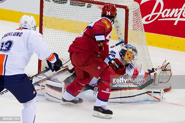Daniel Korso of YunostMinsk scored in the goal of Victor Andren of Vaxjo Lakers during the 2nd period of the Champions Hockey League group stage game...