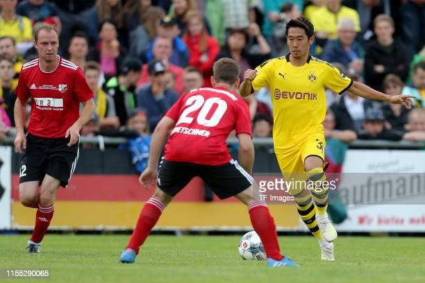 Daniel Kretschmer of FC Schweinberg and Shinji Kagawa of Borussia Dortmund battle for the ball during the preseason friendly match between FC...