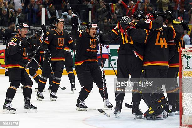 Daniel Kreutzer of Germany celebrates with his team mates after winning the IIHF World Championship qualification round match between Slovakia and...