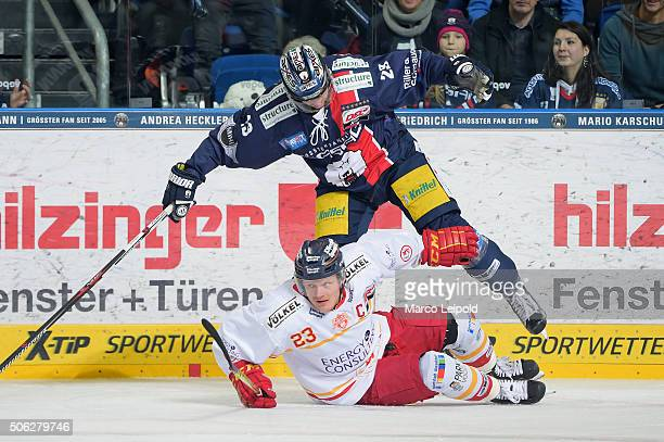 Daniel Kreutzer of the Duesseldorfer EG and Jens Baxmann of the Eisbaeren Berlin during the DEL game between the Eisbaeren Berlin and Duesseldorfer...