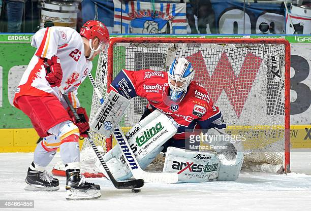Daniel Kreutzer of the Duesseldorfer EG and Petri Vehanen of the Eisbaeren Berlin during the game between Eisbaeren Berlin and Duesseldorfer EG on...