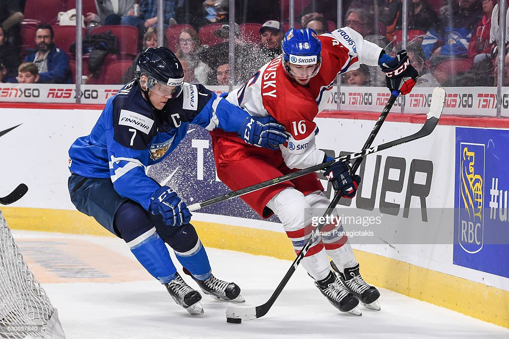Daniel Kurovsky #16 of Team Czech Republic skates the puck against Olli Juolevi #7 of Team Finland during the IIHF World Junior Championship preliminary round game at the Bell Centre on December 26, 2016 in Montreal, Quebec, Canada. Team Czech Republic defeated Team Finland 2-1.