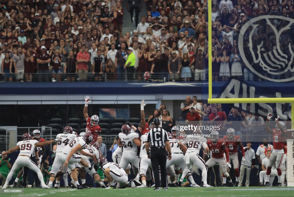 Daniel LaCamera of the Texas A&M Aggies makes a field goal in the fourth quarter against the Arkansas Razorbacks at AT&T Stadium on September 23, 2017 in Arlington, Texas.