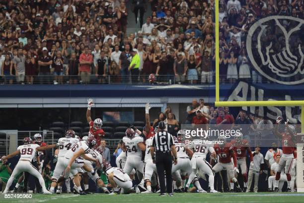 Daniel LaCamera of the Texas A&M Aggies makes a field goal in the fourth quarter against the Arkansas Razorbacks at AT&T Stadium on September 23,...