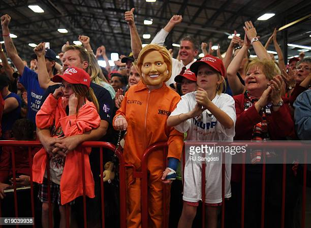 Daniel Lance dresses as Hillary Clinton in a prison orange jumpsuit during a campaign rally for Donald JTrump at the Jefferson County Fairgrounds in...