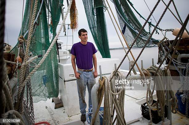 Daniel LaRoche a commercial fisherman who supports Donald Trump as a presidential candidate poses for a photo on his shrimping boat February 22 2016...