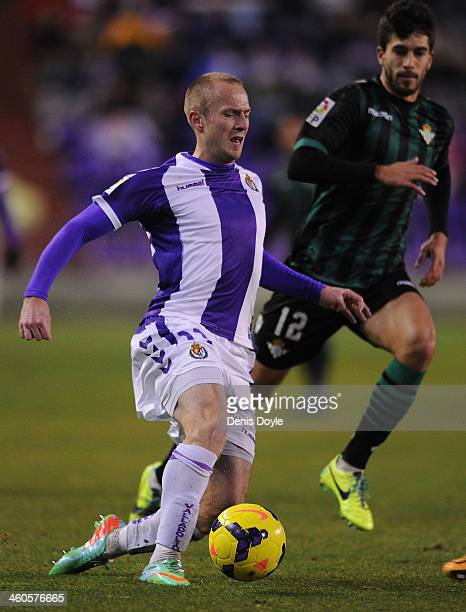 Daniel Larsson of Real Valladolid CF beats Didac Vila of Real Betis Balompie during the La Liga match between Real Valladolid CF and Real Betis...
