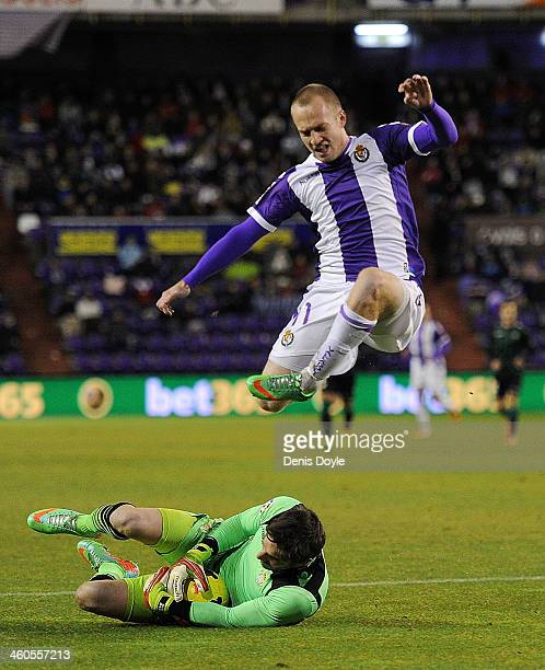Daniel Larsson of Real Valladolid CF is tackled by goalkeeper Guilermo Sara of Real Betis Balompie during the La Liga match between Real Valladolid...
