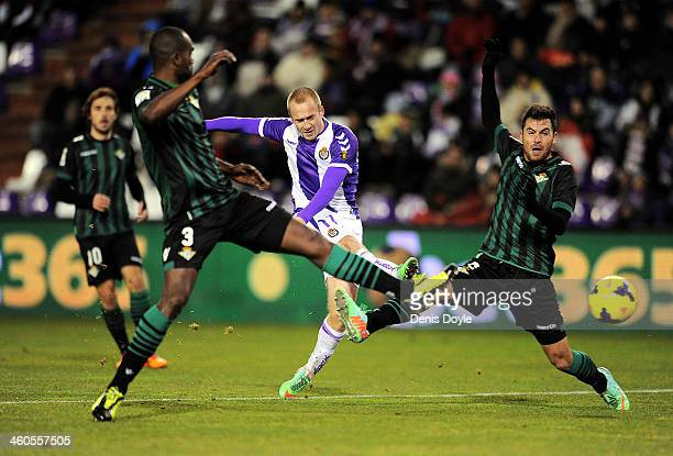 Daniel Larsson of Real Valladolid CF shoots past Paulo Afonso Santos Junior of Real Betis Balompie during the La Liga match between Real Valladolid...