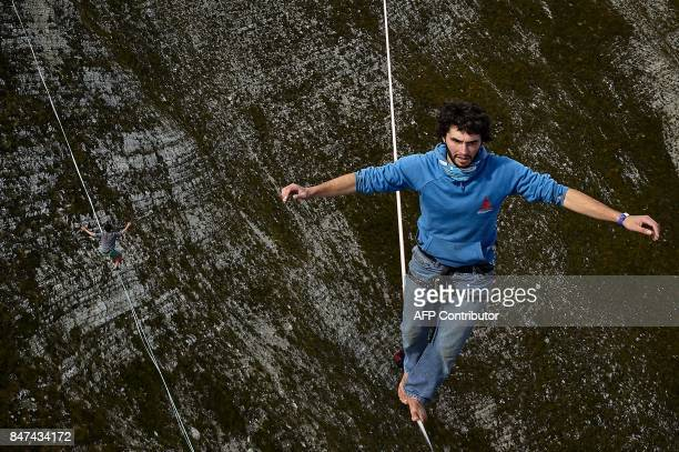Daniel Laruelle of South Africa and Sebastian Gum Chung Segraves walk on lines during the Highline Extreme event in Moleson peak western Switzerland...