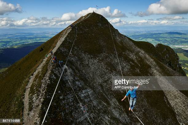 Daniel Laruelle of South Africa walks on the line during the Highline Extreme event in Moleson peak western Switzerland on September 15 2017 Fifty of...