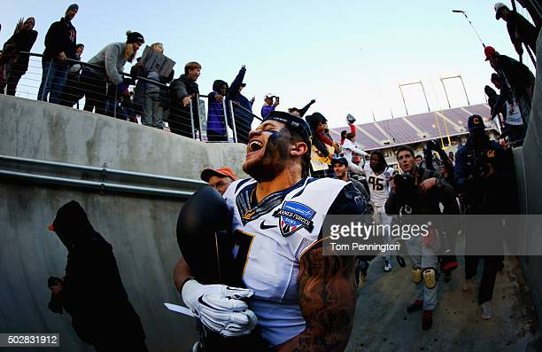 Daniel Lasco of the California Golden Bears celebrates with the championship trophy after beating the Air Force Falcons 5536 in the Lockheed Martin...