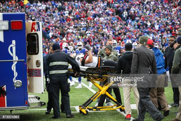 Daniel Lasco of the New Orleans Saints lifts his arm as he is loaded into an ambulance during the second quarter against the Buffalo Bills on...