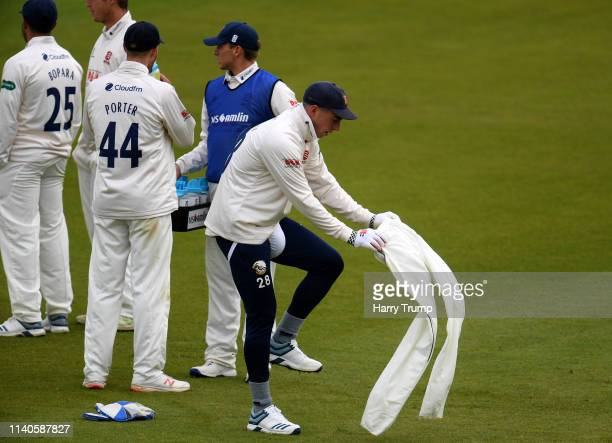Daniel Lawrence of Essex changes on the outfield as he swaps with Adam Wheater of Essex as wicket keeper due to injury during Day One of the...