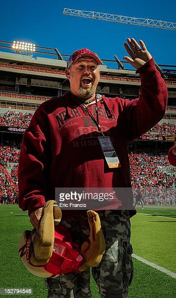Daniel Lawrence Whitney also known as Larry The Cable Guy waves to the crowd after being inducted to the Nebraska Football Hall of Fame before the...