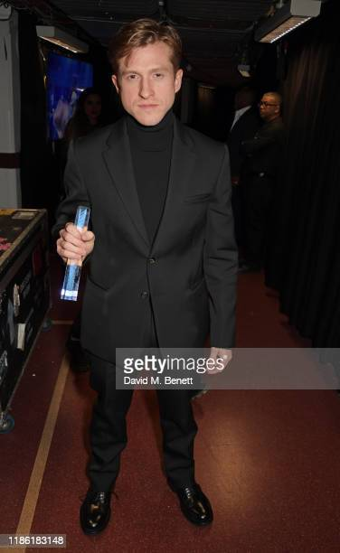 Daniel Lee, accepting the Accessories Designer of the Year award on behalf of Bottega Veneta, poses backstage stage during The Fashion Awards 2019...