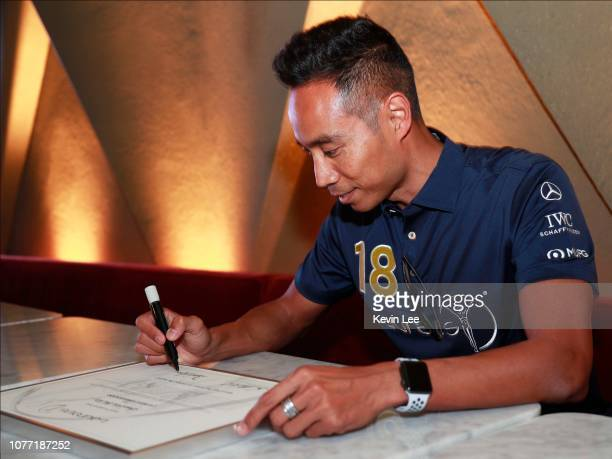 Daniel Lee Chi Woh signs the certificate before the Laureus Hong Kong Ambassador Announcement ceremony at Mercedes Me Store on December 04 2018 in...