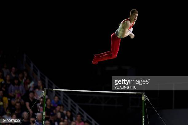 TOPSHOT Daniel Lee of Jersey competes on the horizontal bar during the men's team final and individual qualification during the 2018 Gold Coast...