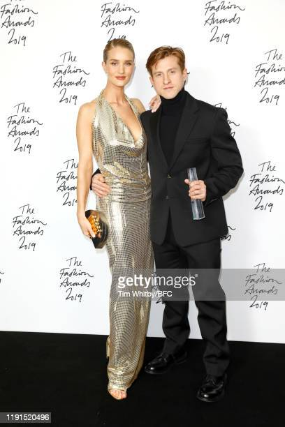 Daniel Lee poses with Rosie HuntingtonWhiteley in the winners room after accepting the Accessories Designer of the Year award on behalf of Bottega...