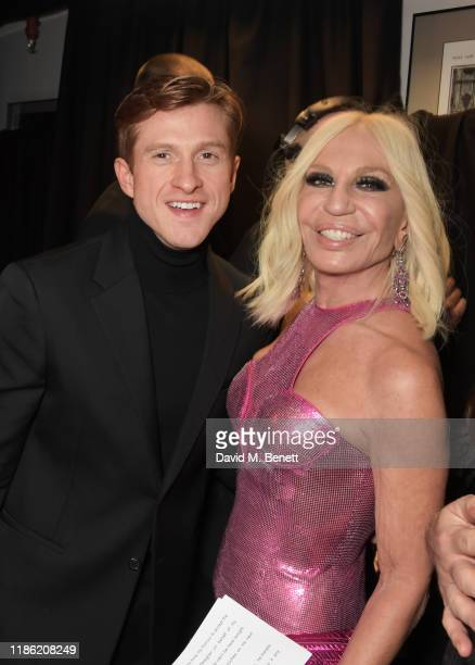 Daniel Lee winner of the Designer of the Year award and Donatella Versace pose backstage stage during The Fashion Awards 2019 held at Royal Albert...