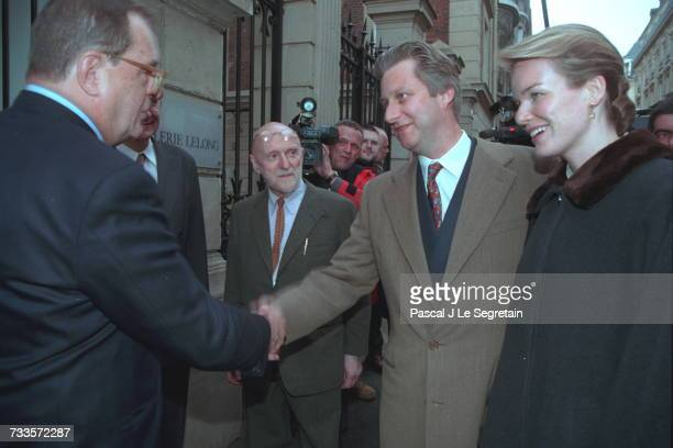 Daniel Lelong welcoming the Belgian princely couple in front of his art gallery Belgian artist Pierre Alechinsky can be seen in the background