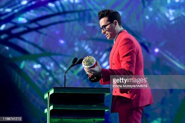 Daniel Levy accepts award onstage at the 2019 MTV Movie and TV Awards at Barker Hangar on June 15 2019 in Santa Monica California