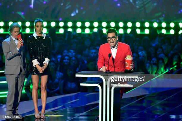 Daniel Levy accepts the Best Comedic Performance award for 'Schitt's Creek' onstage during the 2019 MTV Movie and TV Awards at Barker Hangar on June...