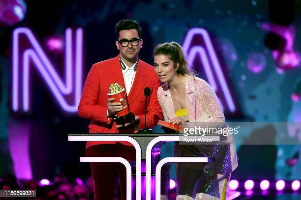 Daniel Levy and Annie Murphy present an award onstage during the 2019 MTV Movie and TV Awards at Barker Hangar on June 15 2019 in Santa Monica...
