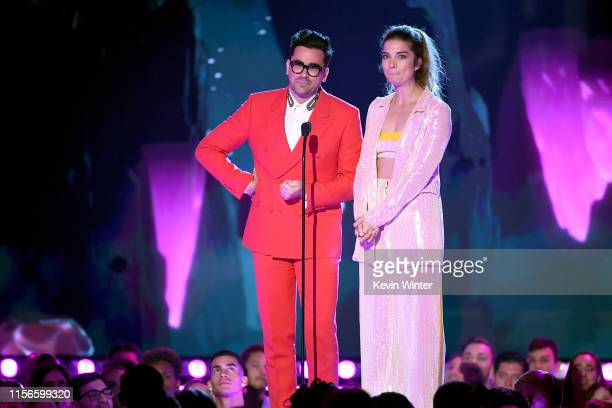 Daniel Levy and Annie Murphy speak onstage during the 2019 MTV Movie and TV Awards at Barker Hangar on June 15 2019 in Santa Monica California