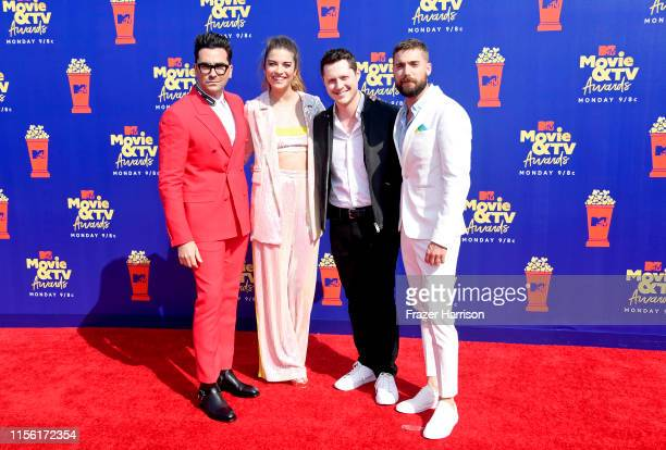 Daniel Levy, Annie Murphy, Noah Reid, and Dustin Milligan attend the 2019 MTV Movie and TV Awards at Barker Hangar on June 15, 2019 in Santa Monica,...
